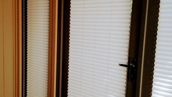Pleated blinds fitted on a customers door